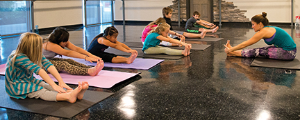 A kids' yoga class at Balance. Yoga. Barre.
