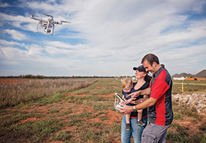 The Brackett family flying a drone