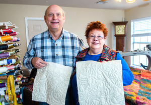 Expressions In Quilting owner Wanda Pinkerton with partner John Yater