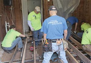 Team members from Boeing work on a house in OKC